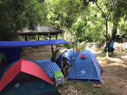campers at khlong paibun waterfall in khao kitchakut national park